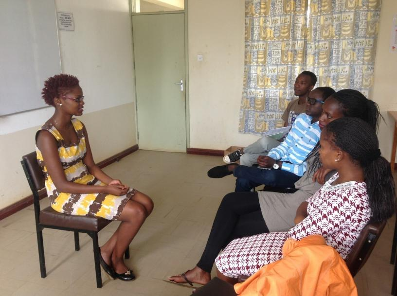 Ruth, who lives with RHD, narrates her experience to the team